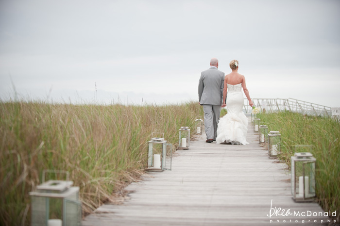 Brea McDonald nantucket wedding photographer wedding shot at the wahwinet working with soiree floral couples portraits on the beach