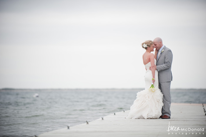 Brea McDonald nantucket wedding photographer wedding shot at the wahwinet working with soiree floral couples portraits  on the ocean