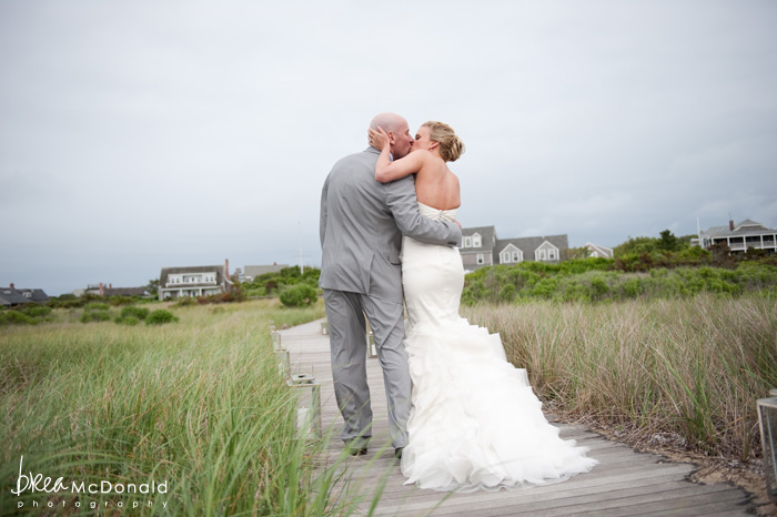 Brea McDonald nantucket wedding photographer wedding shot at the wahwinet working with soiree floral couples portrait on the beach wedding kiss