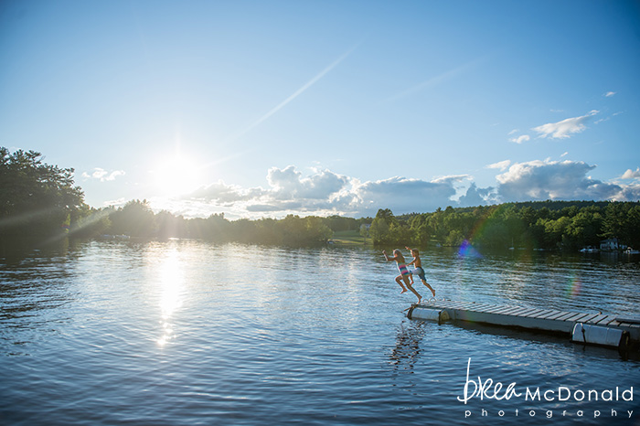 Bow Lake Strafford New Hampshire family portrait session with photographer Brea McDonald of Brea McDonald Photography lifestyle portraits on the lake at a family camp kids having fun swimming summer family portrait